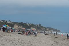 Huge crowd at the Zuma Beach on the Memorial Day, Malibu, California. It appears everyone ended up at the Zuma Beach on the Memorial Day, Malibu, California Stock Photography