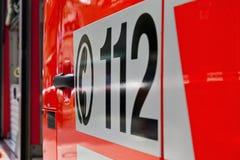 Appel d'urgence 112 sur une ambulance Photographie stock libre de droits
