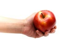 Appel in een hand op een wit Royalty-vrije Stock Afbeeldingen