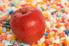 Appel en tabletten Stock Afbeelding