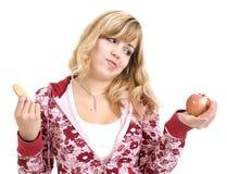 Appel of koekje? Stock Afbeeldingen