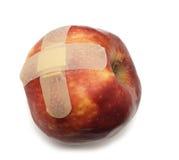 Appel met pleister stock foto