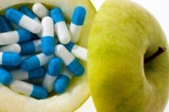 Appel met tablettencapsules. Royalty-vrije Stock Foto