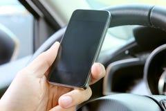 Appel téléphonique dans la voiture Photo stock