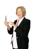 Appel téléphonique effectuant aîné Image stock