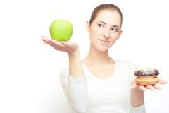 Appel versus cake Royalty-vrije Stock Foto
