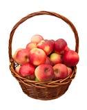 Appelen in geïsoleerden mand Stock Foto's