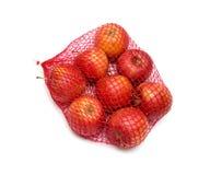 Appelen in het rode net worden verpakt dat stock afbeelding