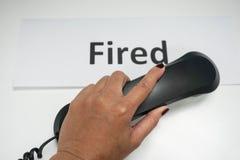 Appeler pour mettre le feu à l'employé Photographie stock libre de droits