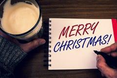 Appell för glad jul för ordhandstiltext Motivational Affärsidéen för semesterperiodberöm December uttrycker notepadhänder Arkivbilder