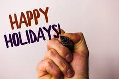Appell för lyckliga ferier för ordhandstiltext Motivational Affärsidéen för att hälsa fira festliga dagar Man pointin för hålland Royaltyfria Foton