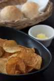 Appetiser. Chips butter and bread Royalty Free Stock Photos