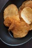 Appetiser chips. Appetiser potato chips on black bowl Royalty Free Stock Image