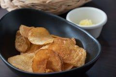 Appetiser. Fresh appetiser chips and bread in a basket Stock Image