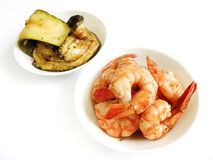 Appetisers, cold prawns and zucchini. A photograph image of some dishes of starters or appetizers - marinated prawn, and char grilled zuchini.  Served in white Stock Image