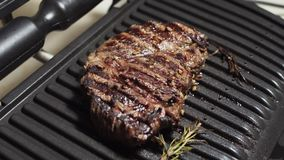 Appetising beef steak ready to eat. Meat marinated with herbs on a home electric grill.