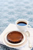 Appetising chocolate dessert with coffee. Cup of coffee served with a delicious and decadent chocolate pie stock photo