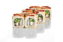 Appetising japanese cuisine California sushi roll with eel on white. Appetising California sushi roll with eel on white. CLose up on white background stock photography