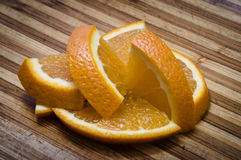 Appetising juicy orange slices. Lie on a wooden board royalty free stock image