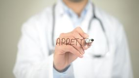 Appetite, Doctor writing on transparent screen. High quality Stock Photos