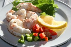 Appetizer. Lobster tails with lemon and vegetables royalty free stock photography