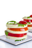 Appetizer. A light snack of cheese, tomato, and rocket salad Stock Photography