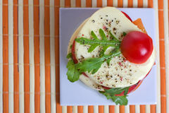 Appetizer. A light snack of cheese, tomato, and rocket salad Royalty Free Stock Photo