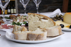 Appetizer. On white restaurant table - bread with lard (mediterranic traditional royalty free stock images