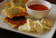 Appetizer. A delicious appetizer consisting of fried raviolis fresh mozzarella and marinara dipping sauce Stock Photo