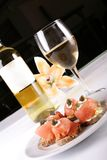 Appetizer. Raw fish appetizer with white wine for special occasions stock image