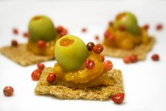 Appetizer. Small colorful appetizers on a white plate Stock Images