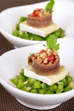 Appetizer with anchovy and brie. Decorated with parsley Royalty Free Stock Photos