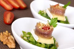 Appetizer with anchovy and brie Stock Images