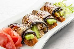 Appetizer with aubergine and eel stock images