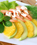 Appetizer of avocado and shrimp with orange Royalty Free Stock Image
