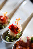 Appetizer with bacon and pesto in a spoon Royalty Free Stock Images