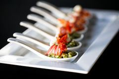 Appetizer with bacon and pesto in a spoon Stock Photos