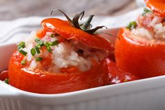 Appetizer of baked tomatoes filled with rice, vegetables macro Stock Photo