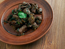 Appetizer beef liver. Antep  kavurma - Appetizer beef liver.Turkish cuisine Royalty Free Stock Image
