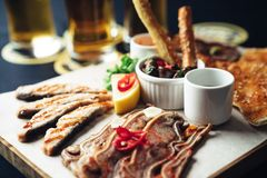 Appetizer beer set. Fried appetizer beer sidedish on cutting board Stock Images