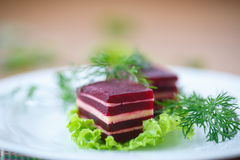 Appetizer of beet and cheese on lettuce leaves Royalty Free Stock Images