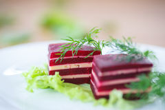 Appetizer of beet and cheese on lettuce leaves Stock Photo