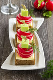 Appetizer of black bread with radish Stock Photos