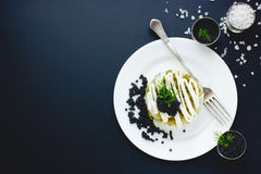 Appetizer with black caviar on black background, example serving Stock Photos