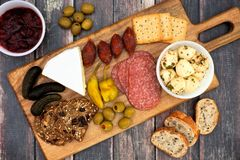 Appetizer board over a wooden background Stock Image