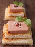 Appetizer, bread with foie gras Stock Photos