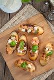 Appetizer bruschetta. Stock Photos