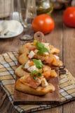 Appetizer bruschetta. Royalty Free Stock Photos