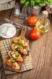 Appetizer bruschetta. Royalty Free Stock Photography