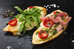 Appetizer bruschetta with tomato and bacon Royalty Free Stock Image